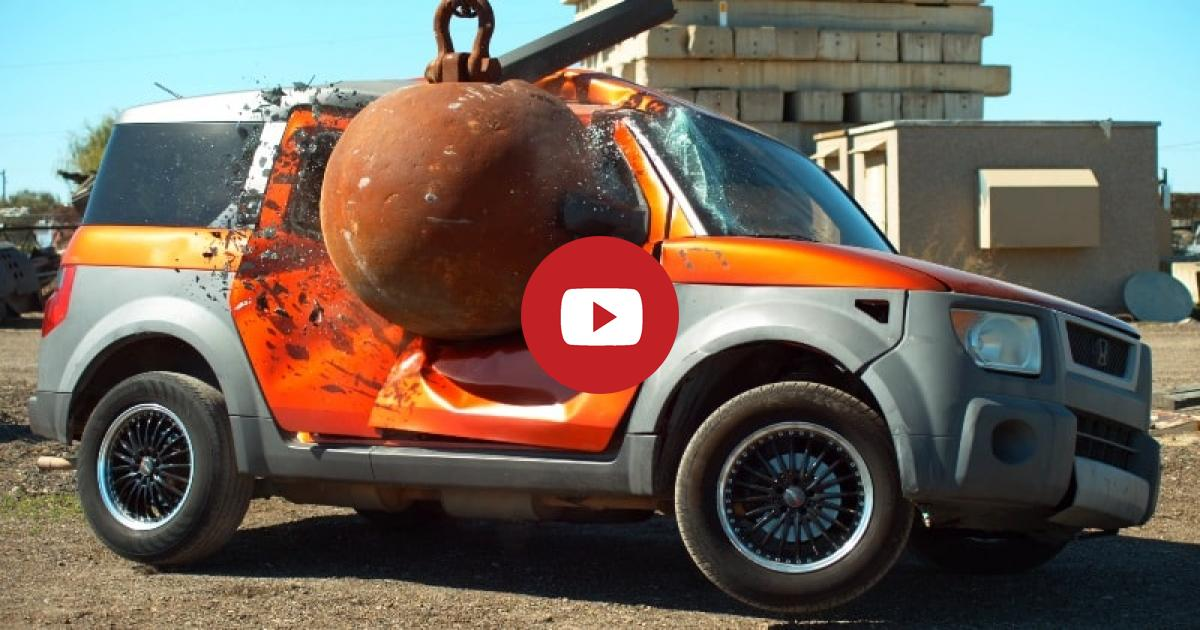A Group Of Guys Research The Effects Of A 4-Ton Wrecking Ball Smashing Into Different Cars Including BMW.