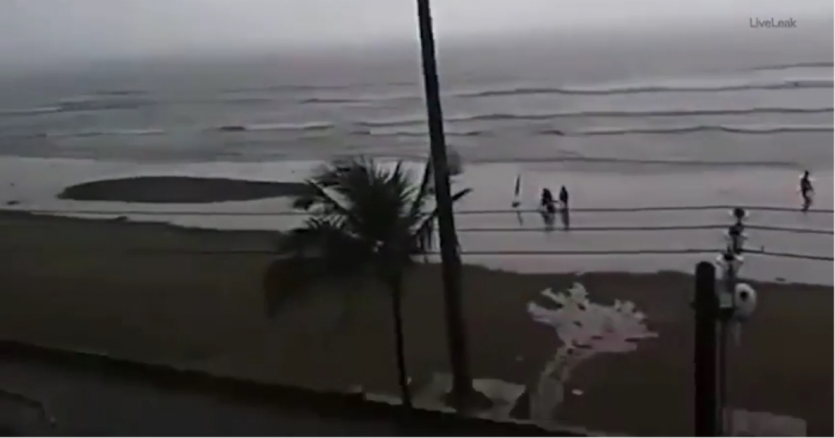 Young Woman Is Struck By Lightening While Strolling Along Beach Captured On Camera.