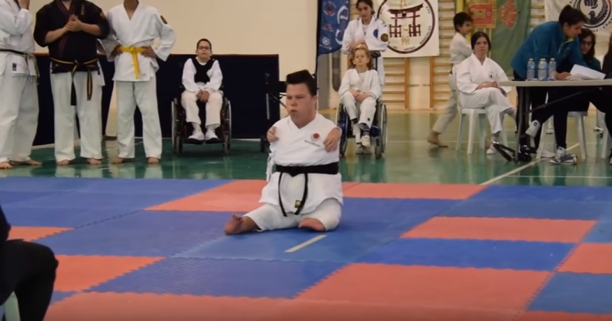 Man Without Short Limbs Earns Black Belt In Martial Arts.