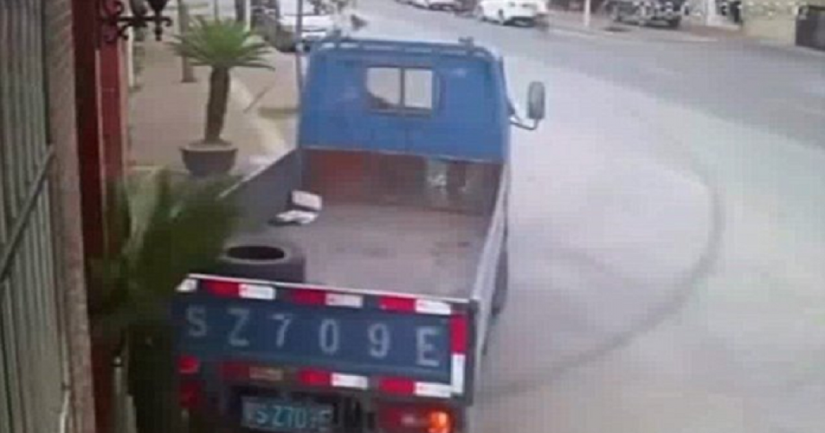 Truck Spins 180 Degrees On A Busy Road As The Driver Swerves An Oncoming Car And Ends Up Parking Perfectly.