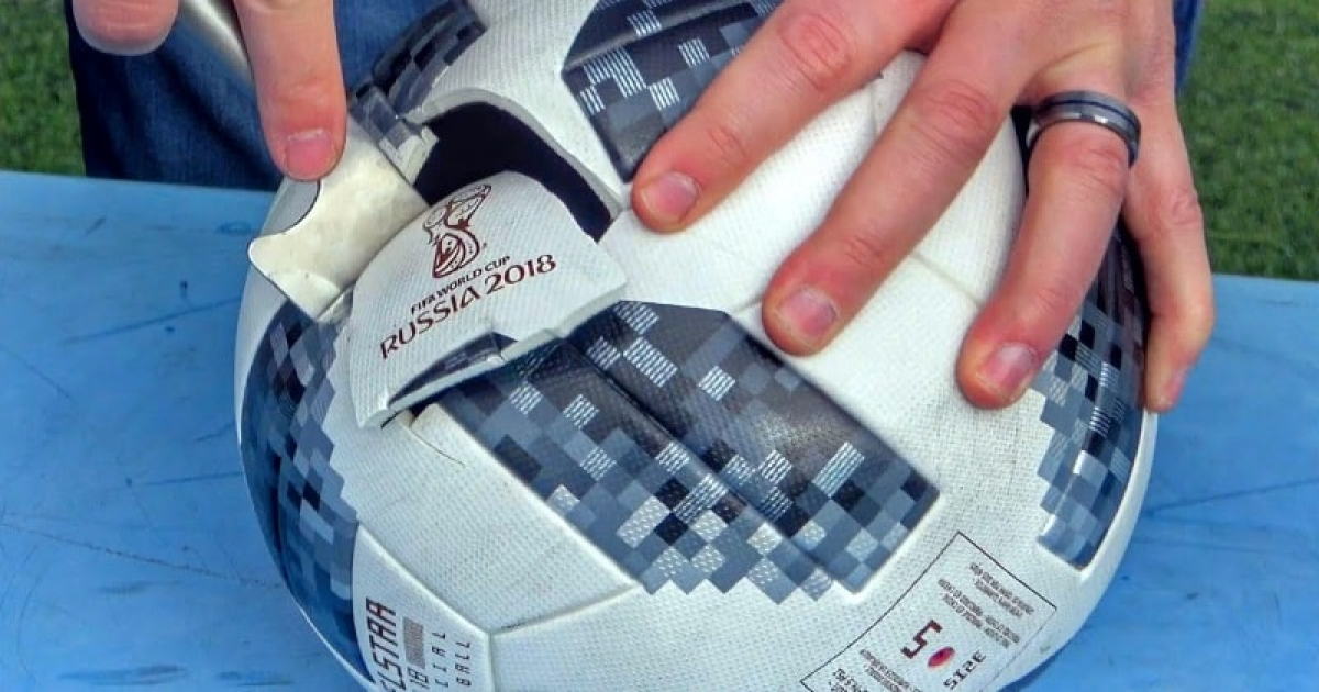 Father And Son Cut Open World Cup Soccer Balls To See What's Inside.