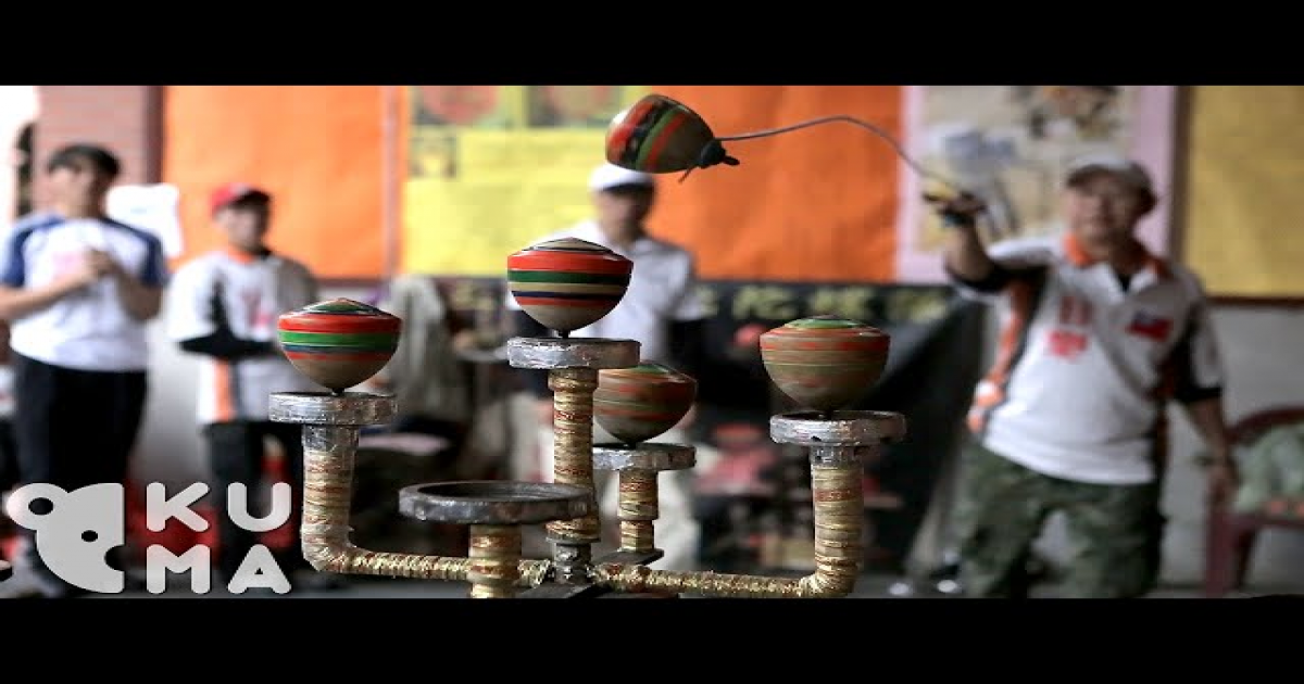 These Spinning Top Masters Perform Seemingly Impossible Trick Shots With The Traditional Children's Toys.