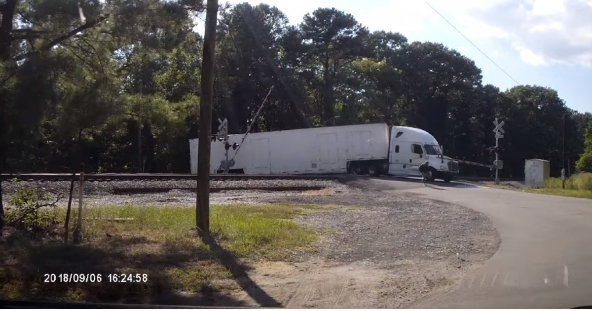 Lucky Driver Escapes Massive Lorry Just Before It's Cut In Half By Freight Train.