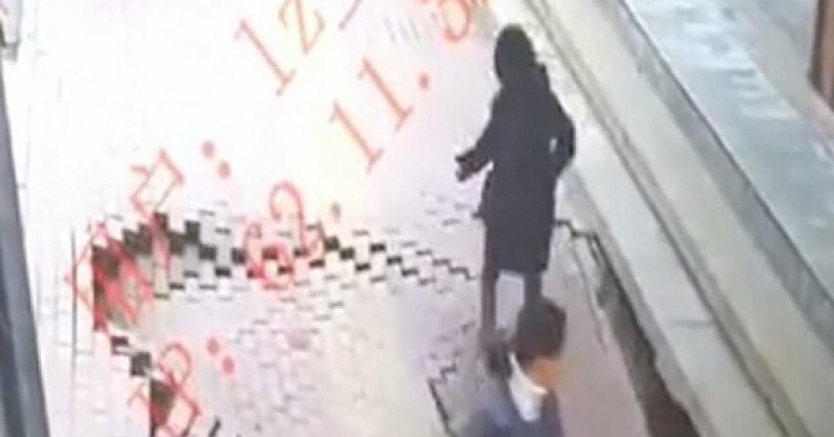 Chinese Woman Suddenly Disappears Down Sinkhole As She Strolls Along Pavement.